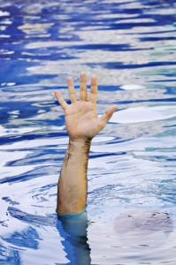 Hand rising out of water indicating the need for those with PTSD to seek professional help