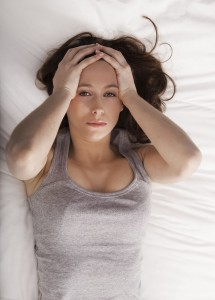 Woman with insomnia in bed awake